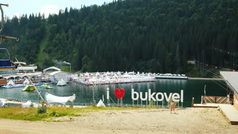 An-Artificial-Lake-And-A-Luxurious-Resort-Near-It-Heart-And-Bukovel-Inscription