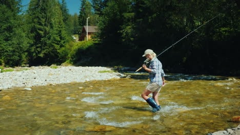 A-Woman-With-A-Fishing-Rod-Passes-Into-A-Ford-A-Small-Mountain-River-Active-Way-Of-Life-And-Fishing