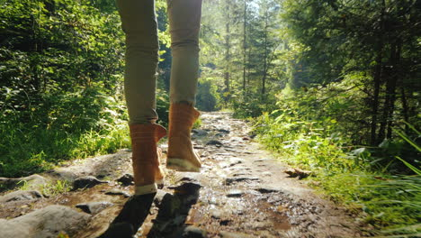 Follow-Shot:-A-Man-In-Trekking-Boots-Walks-Along-A-Slippery-Stony-Path-In-The-Forest-Hiking-And-Acti