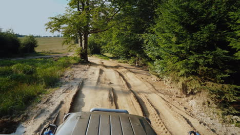 Suv-Rides-On-An-Extremely-Bad-Dirt-Road-A-Top-View-Stabilized-On-3-Axes-Shot