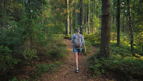 Woman-Tourist-With-A-Backpack-Goes-Along-The-Forest-Path