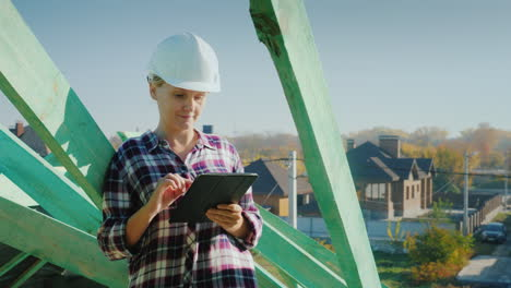 A-Female-Architect-Is-Working-With-A-Tablet-On-The-Roof-Of-A-House-Technical-And-Author-s-Control-In