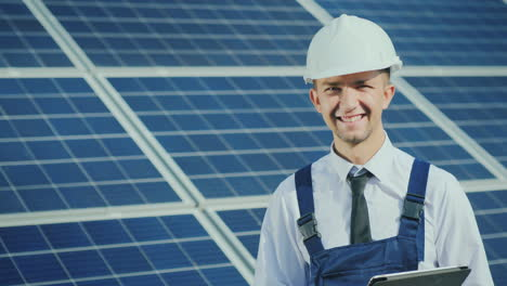 Portrait-Of-A-Successful-Young-Engineer-On-The-Background-Of-A-Solar-Power-Station