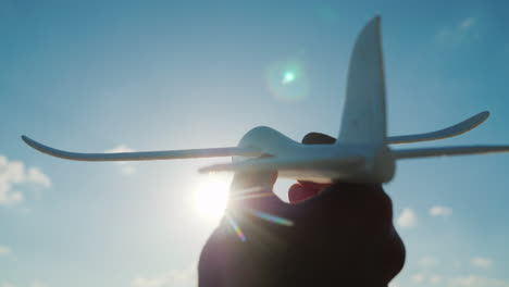 The-Hand-Holds-A-Toy-Like-Plane-Rushing-Toward-The-Sky-To-The-Sky-Dream-And-A-Good-Startup-Concept-4