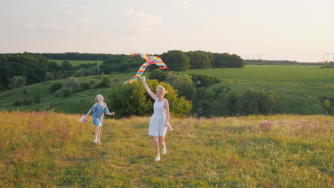 Woman-With-A-Girl-Running-With-An-Air-Kite-Happy-Mom-With-Daughter-Concept-4K-Slow-Motion-Video