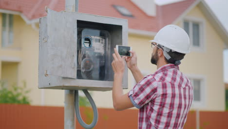 The-Inspector-Takes-Pictures-Of-The-Meter-Reading-4K-Video