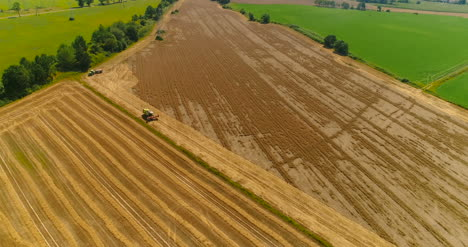 Combine-Harvester-And-Tractor-Working-In-Agricultural-Field-4K