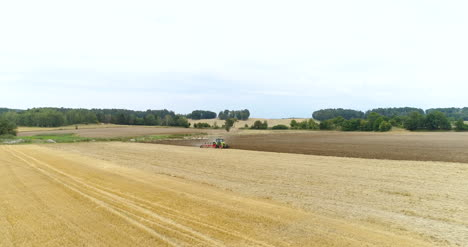 Wide-Shoot-Of-Tractor-Working-On-Agricultural-Field-