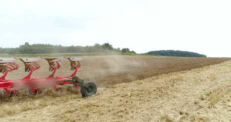 Agricultural-Tractor-Sowing-And-Cultivating-Field-1