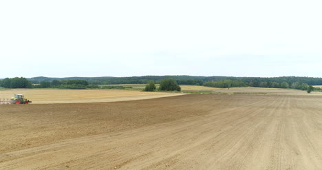Agriculture-Wide-Shoot-Of-Tractor-Plowing-Field-4K-4