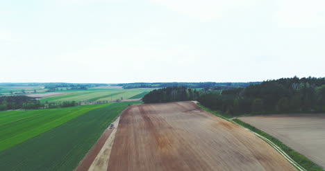 Aerial-Of-Combine-Harvesting-Wheat-Field