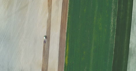 Aerial-Shoot-Of-Tractor-Working-On-Field-1