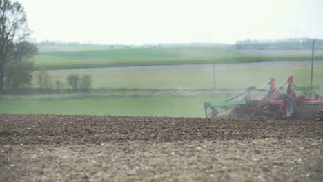 Cultivating-Background-Harvesting-Field-Agricultural-Tractor-Plowing-Field-