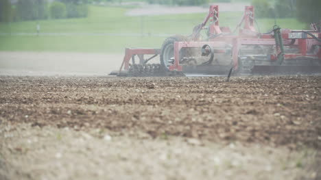 Agricultural-Tractor-Cultivating-Field-2