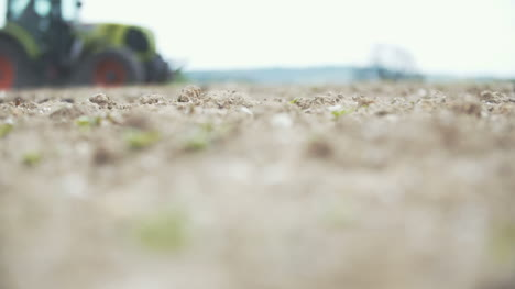 Agriculture-Slowmo-Shoot-Of-Agricultural-Tractor-Sowing-And-Cultivating-Field-