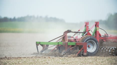 Detail-Shoot-Of-Harrows-Cultivating-Field-