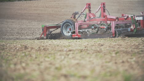 Agriculture-Background-Farmer-Cultivating-Field-Using-Harrows-Slowmotion-