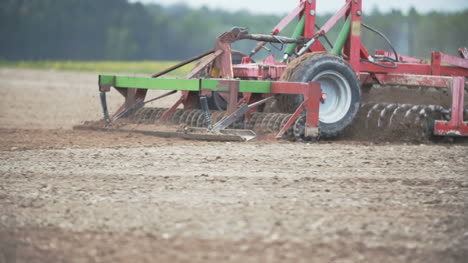 Tracking-Shoot-Of-Tractor-Plowing-Field-
