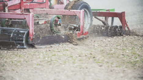 Close-Up-Of-Farmer-Cultivating-Field-Using-Harrows-Slowmotion-Shoot-