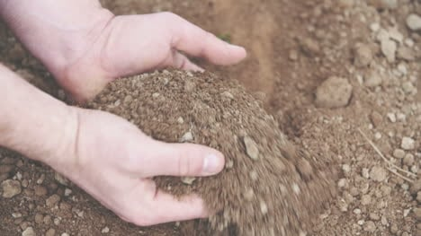 Farmer-With-Handful-Of-Soil-Agriculture-Background-