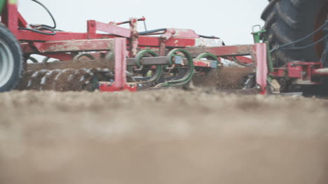 Farmer-Cultivating-Field-Using-Harrows-Slowmotion-Shoot-