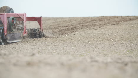 Farmer-Cultivating-Field-Using-Harrows-Slowmotion-Shoot-1