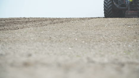 Agriculture-Detail-Shoot-Of-Agricultural-Tractor-Sowing-And-Cultivating-Dry-Field