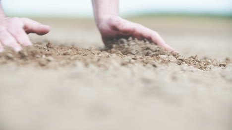 Farmer-Checking-Soil-Before-Planting-Wheat-