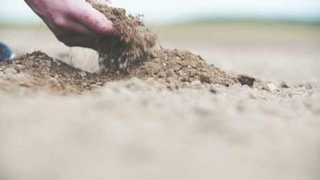 Young-Farmer-Holding-Soil-In-Hands-