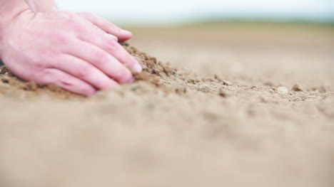 Agricultural-Background-Farmer-Holding-Soil-In-Hands-