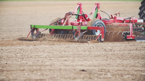 Farmer-Cultivating-Field-Close-Up-View-1