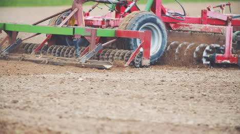 Slowmotion-Of-Tractor-Plowing-Field-Using-Harrows