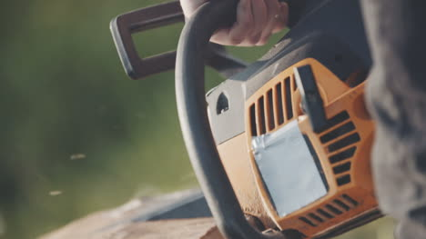 Close-Up-Of-Man-Using-Chainsaw-