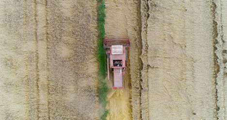 Combine-Harvester-Working-In-Agricultural-Field