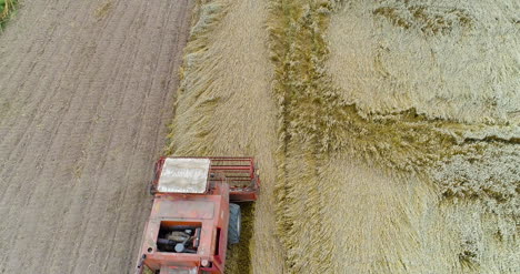 Combine-Harvester-Working-In-Agricultural-Field-1