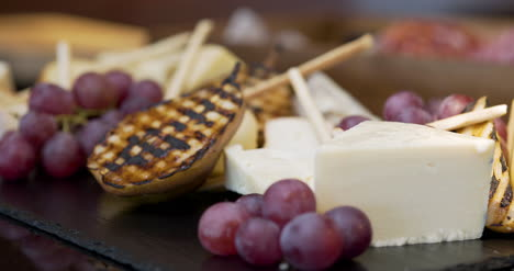 Different-Types-Of-Cheese-On-Wooden-Board-In-The-Restaurant-1