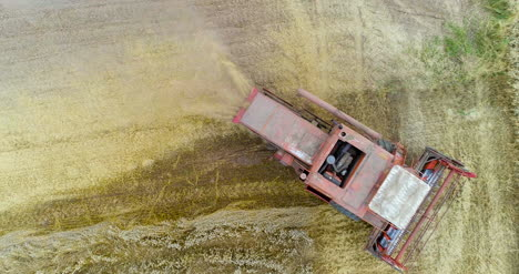 Combine-Harvester-Working-In-Agricultural-Field-4