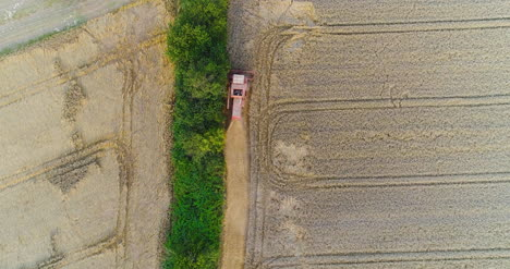 Combine-Harvester-Working-In-Agricultural-Field-7