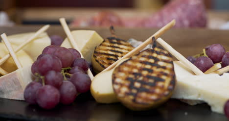 Different-Types-Of-Cheese-On-Wooden-Board-In-The-Restaurant-2