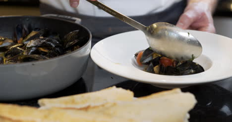 Chef-Is-Decorating-The-Mussel-Dish-2