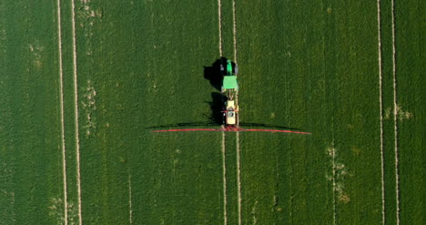 Tractor-Spraying-Pesticides-On-Wheat-Field