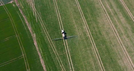 Tractor-Spraying-Pesticides-On-Wheat-Field-1