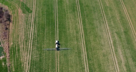 Tractor-Spraying-Pesticides-On-Crops-At-Agriculture-Field-1