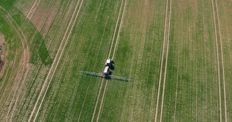 Tractor-Spraying-Pesticides-On-Wheat-Field-2