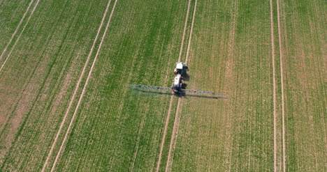 Tractor-Spraying-Pesticides-On-Crops-At-Agriculture-Field-2