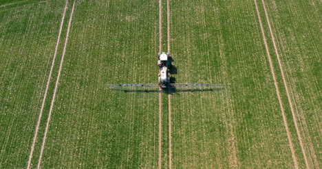 Tractor-Spraying-Pesticides-On-Wheat-Field-3