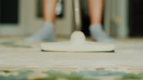 Woman-Vacuuming-A-Carpet-In-A-House-Video-With-Shallow-Depth-Of-Field