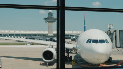 Passenger-Airliner-Outside-The-Airport-Terminal-Window