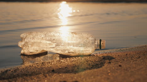 Plastic-Trash-On-The-Seashore-The-Bottle-Lies-On-The-Edge-Of-The-Water