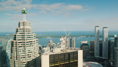 View-From-A-Tall-Building-To-The-City-Of-Toronto-And-The-Bay-Where-Yachts-Swim